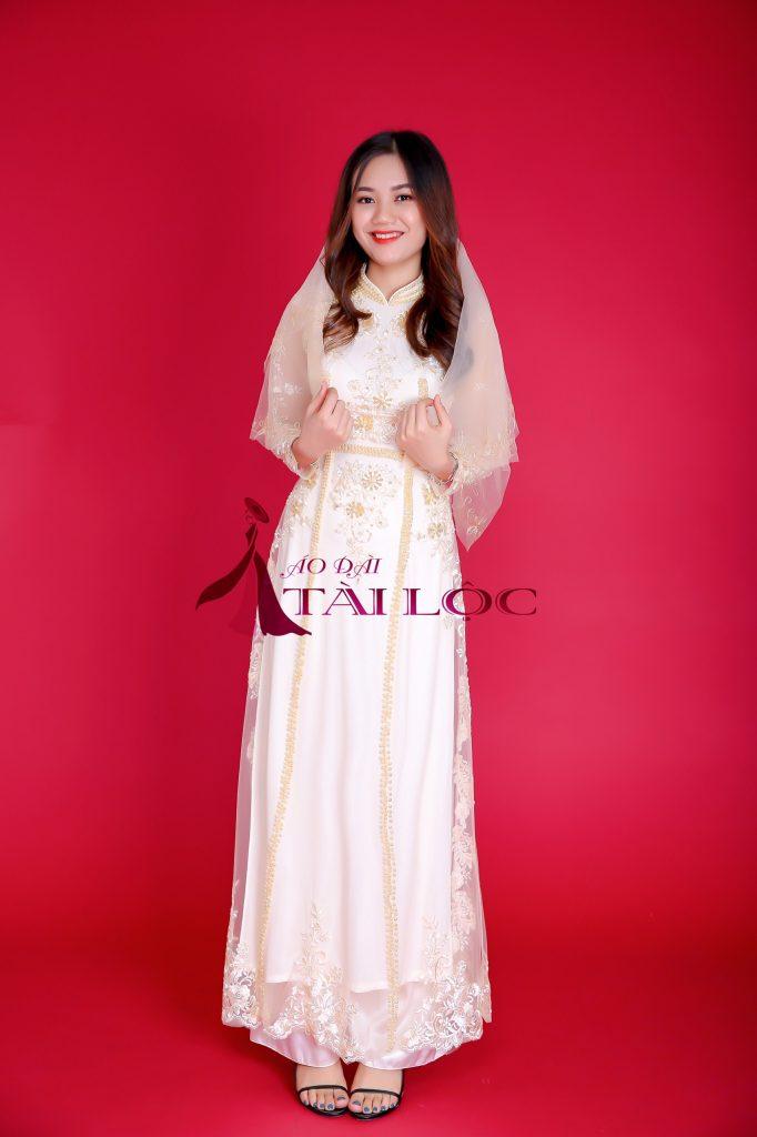 Áo dài cưới cô dâu màu vàng vải ren