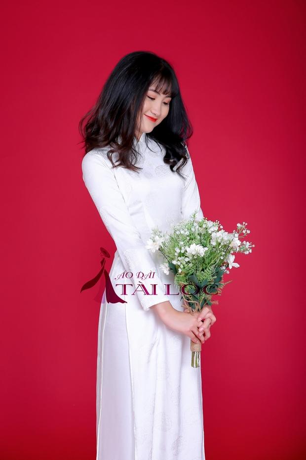 Áo dài cô dâu màu trắng chữ hỷ
